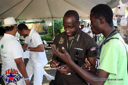 Haiti Police Chief Mario Andresol Giving An Autograph